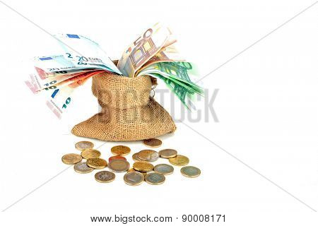 Bag full of euro money notes and coins on a white background