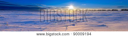 Snowy Field At Sunset