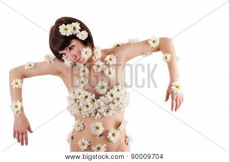 fashionable beautiful woman with chrysanthemums on the body