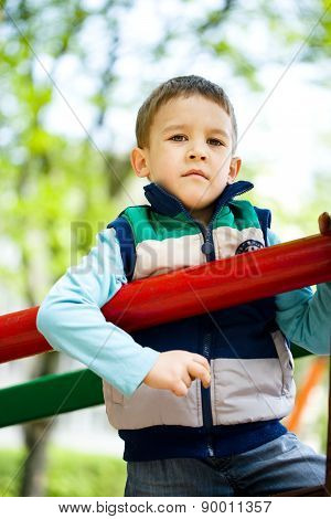 Little Boy Is Playing On Playground