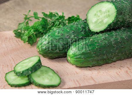 The cut cucumber on a board