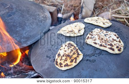Pita Bread Baking On A Saj Or Tava