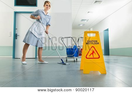 Janitor With Mop And Wet Floor Sign