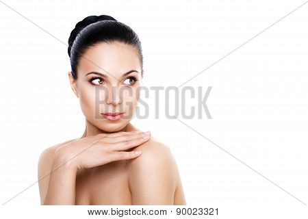Beautiful Young Woman With Fresh Clean Skin. Hand Touching The Shoulder And Looking Away. Isolated O