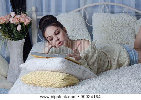 Girl reading a book lazily