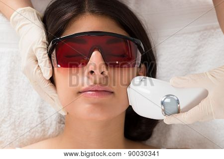 Close-up Of Beautician Giving Epilation Laser Treatment On Woman's Face poster