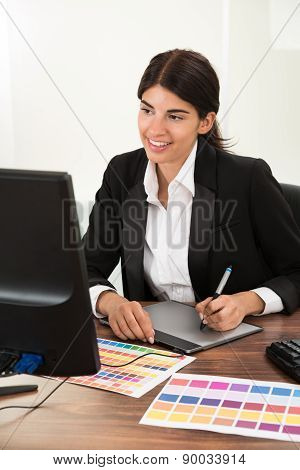 Designer Using Graphic Tablet With Color Sample