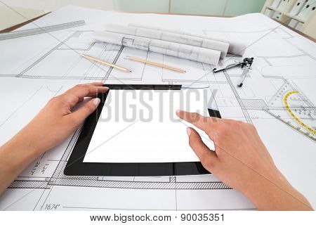 Draftsman With Digital Tablet And Blueprint