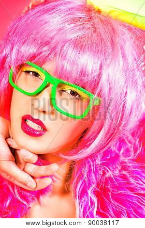 Charming fashion model alluring in sexy colourful clothes. Bright fashion. Pin-up, pink style. Optics, eyewear. Studio shot.