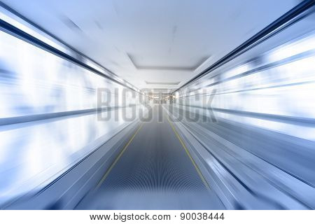 Travelator in motion - abstract business and architectural background