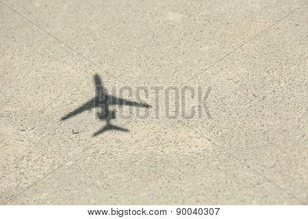 Model of plane over asphalt background