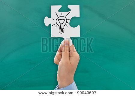 Person Hand Showing Bulb Symbol