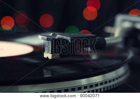 Gramophone with a vinyl record, closeup