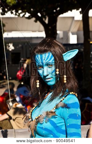 Colorful Girl Made Up As Avatar Figure At Book Fair In Frankfurt