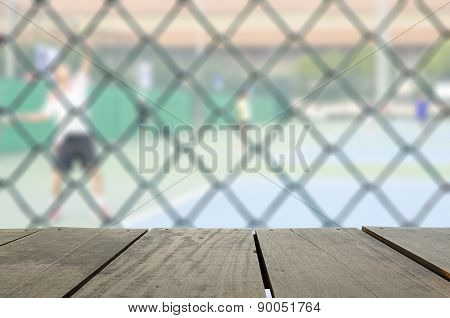 Defocus And Blur Image Of Terrace Wood And Tennis Court With Ten