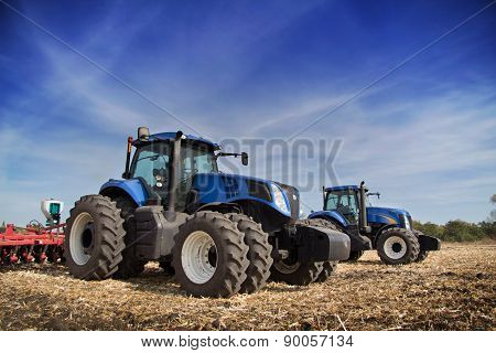 Two Tractor Drills In The Field