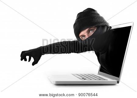 poster of anonymous hacker and cyber criminal man coming out from computer laptop screen with grabbing and stealing hand in black glove as conceptual password hacking and cyber crime