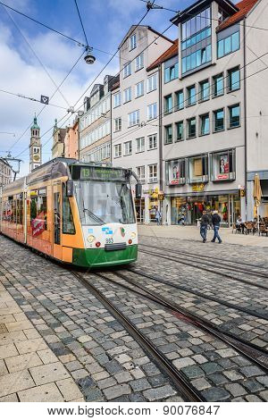 AUGSBURG, GERMANY - SEPTEMBER 28, 2013: A tram passes through the streets of Augsburg. The Augsburg tram has a history dating back to 1881.