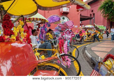 Unidentified Man Ride Trishaw, A Blooming Vehicle On The Road