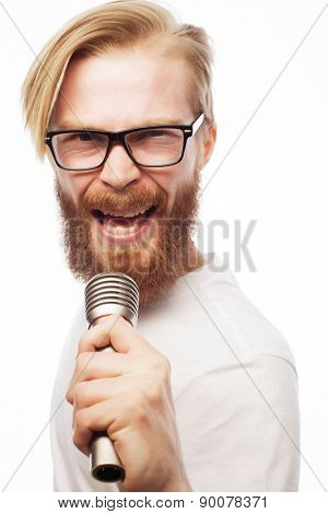 A young man with a beard wearing a shirt holding a microphone and singing, hipsterstyle. Over white background.