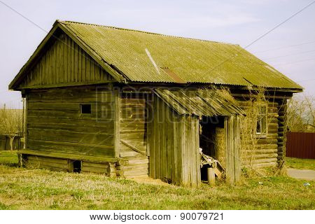 The back of the empty wooden house in Russian village
