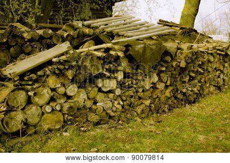 Stack of firewood in the Russian village