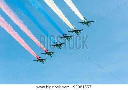 MOSCOW - MAY 7: Fighters do smoke in colors of Russian flag at last rehearsal of the parade dedicated to 70th anniversary of the victory in the Second World War in Red Square on May 7, 2015 in Moscow
