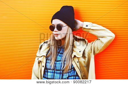 Fashion Portrait Of Stylish Hipster Girl Posing Outdoors In The City Against A Colorful Wall