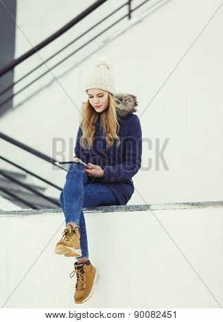 Fashion, Technology And People Concept - Pretty Woman Using Tablet Pc In The City