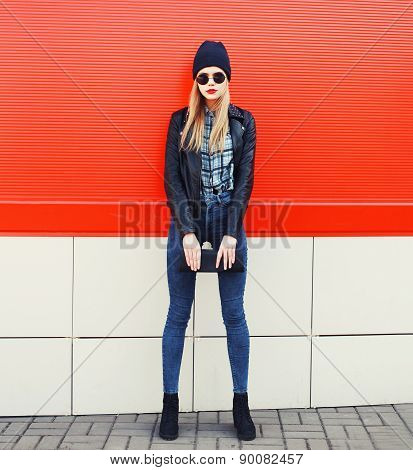 Fashionable Blonde Girl In Rock Black Style, Wearing A Sunglasses And Leather Jacket Standing Outdoo