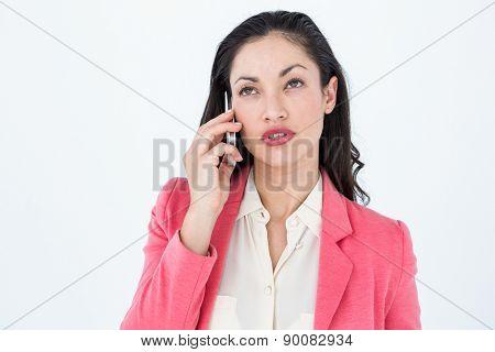 Elegant brunette calling on the phone on white background