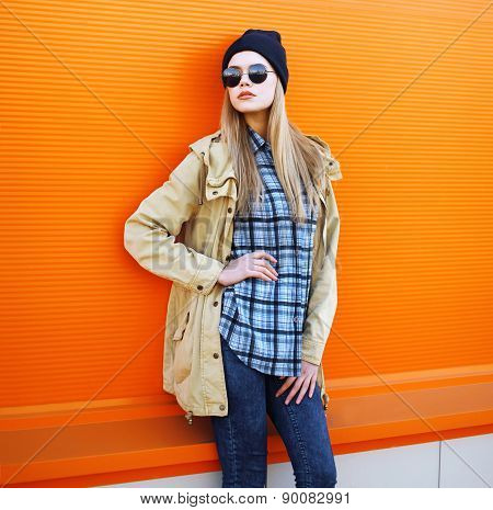 Outdoor Fashion Portrait Of Stylish Hipster Cool Girl Against A Colorful Urban Wall