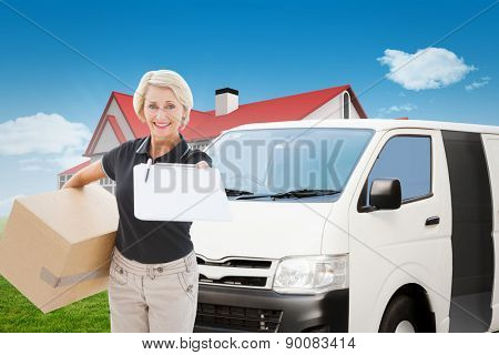 Happy delivery woman looking for signature against blue sky