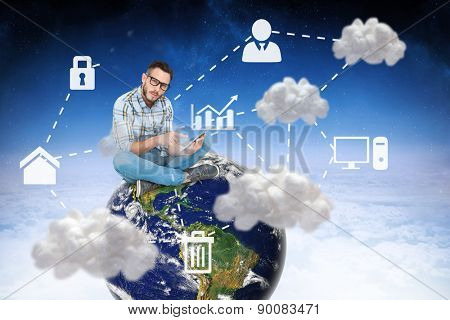 Handsome hipster using tablet pc against cloud computing graphic with icons