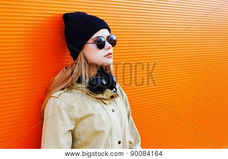 Pretty Blonde Wearing A Black Hat And Headphones Listens To Music Enjoys Freedom, Cool Hipster Girl