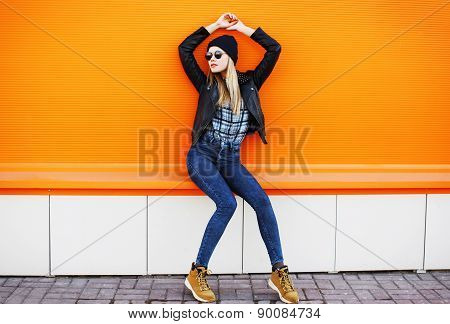 Street Fashion Concept - Stylish Cool Girl In Rock Black Style Posing Against A Colorful Urban Wall