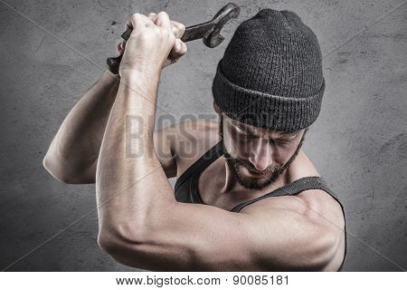 Violent Man Using A Spanner As A Weapon