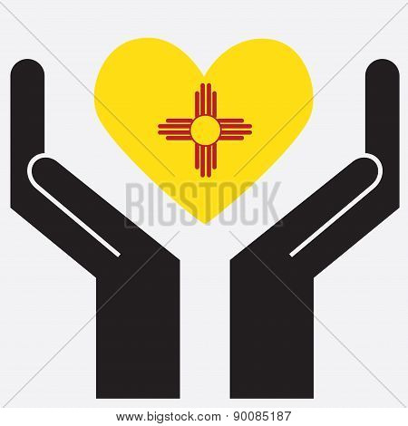 Hand showing New Mexico flag in a heart shape.