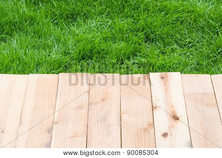Wood On Grass Background