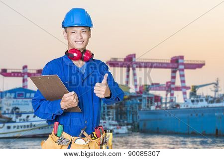 workers on the background stock port with cranes and containers