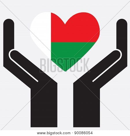 Hand showing Madagascar flag in a heart shape.