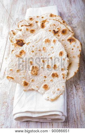 Homemade Whole Wheat Flour Tortillas On A Wooden Table.
