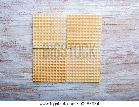 Crispy Wafers On White Wooden Table
