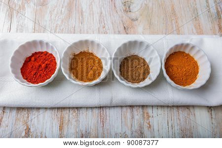 Various Kinds Of Spices On Wooden Table