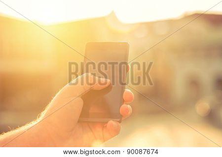 Man with telephone under sunlight