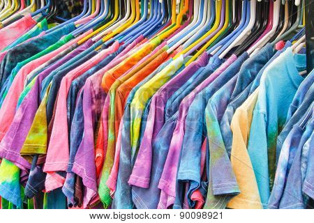 Colorful T-shirts Haning On A Rack