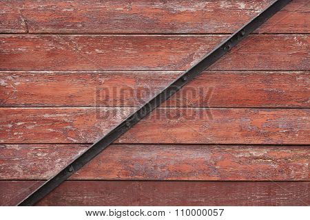 Red Planks Background With Black Metal Bar
