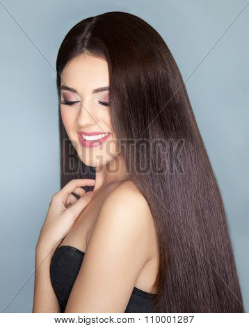 Young happy smiling beautiful brunette woman with healthy long brown hair. Beauty haircare and hairdressing concept