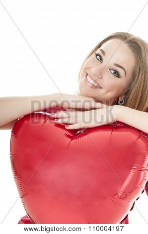 Smiling Woman Holding Red Heart Balloon Over White Background. Valentines Day Concepts.
