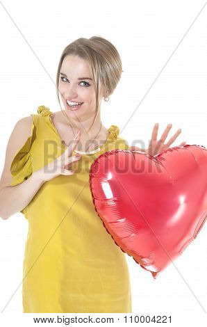 Funny Woman Holding Red Heart Balloon Over White Background. Valentines Day Concepts.